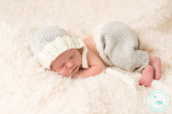 Newborn baby girl in grey outfit