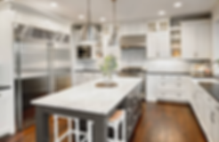 Brand new kitchen. White cabinets stainless steel appliances with sub zero refrigerator. Hardwood floor tiles, white granite center island and dark counter tops.
