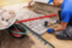 Mason installin paver blocks for new walkway