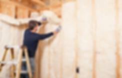 Handyman installing insulation