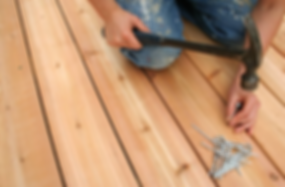 Handyman install deck flooring with nails