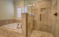 Tile bathroom. Hot tub with glass walls. Tile floor, white walls and large windw.