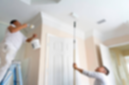 Two painters painting ceiling and crown molding.