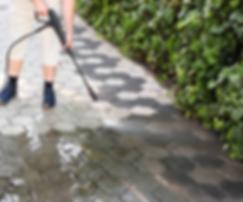 Handyman pressure washing paver blocks