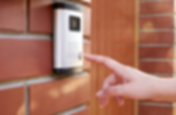 Person pressing a door bell camera