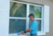 Handyman applying caulking to a window sill