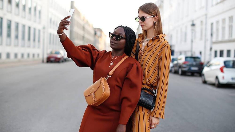 Influencers Lois Opoku and Jacqueline Zelwis during Copenhagen Fashion Week