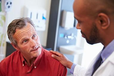 bigstock-Male-Patient-Being-Reassured-B-