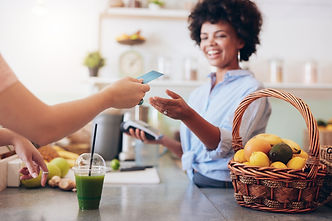 bigstock-Juice-Bar-Owner-Taking-Payment-