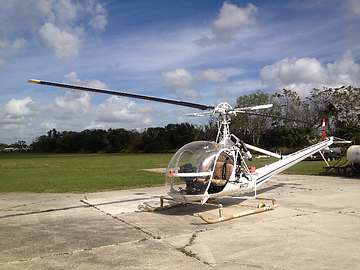 white helicopter being built interior
