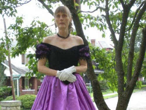 Kate in her own creation, a replica 1860 ball gown.