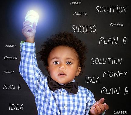 Portrait of little African genius boy wi