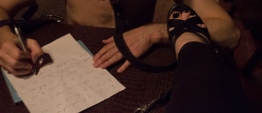 Mistress humilates her slave with a slave contract and foot humiliation