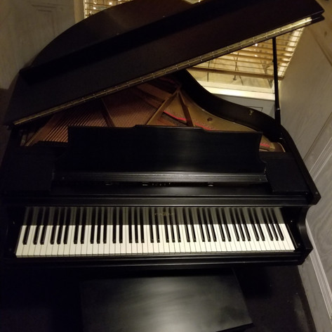 Here's another shot of the piano in the auction!