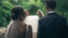 bride and groom walk on their wedding da