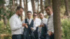 Groom and groomsmen in the woods during