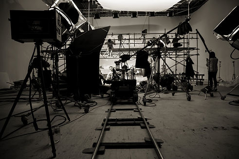 Wide shot of a film set with dolly and track in foreground
