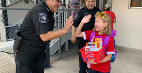 Constable Adan Ballesteros Welcomes Children Back to School