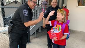 Constable Adan Ballesteros Welcomes Children Back to School