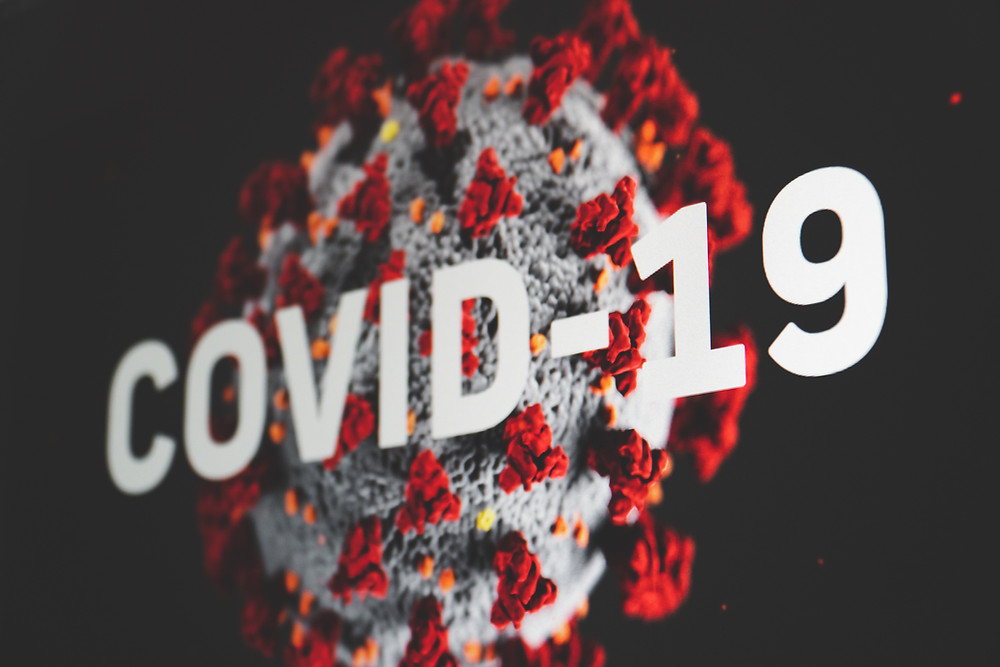 Graphic of coronavirus with COVID-19 text overlay.