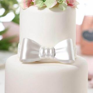 Elegant White Resin Bow Cake Topper
