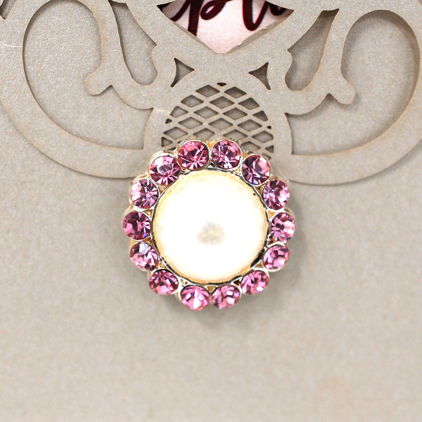 A pearl and pink diamond brooch
