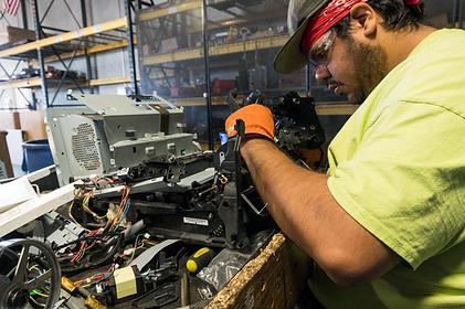 desert arc employee fixing machine