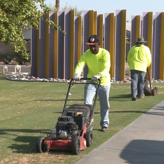 Desert Arc Landscape Maintenance - Client Mowing Lawn