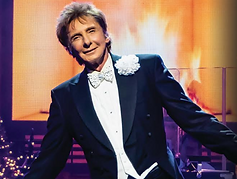 Barry Manilow performing at concert