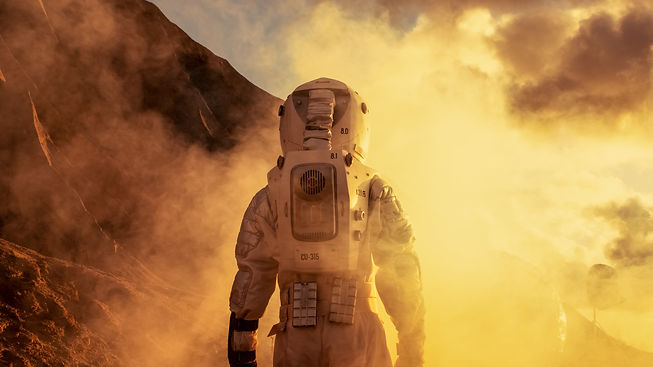 Courageous Astronaut in the Space Suit Explores Red Planet Mars Covered in Mist. Adventure