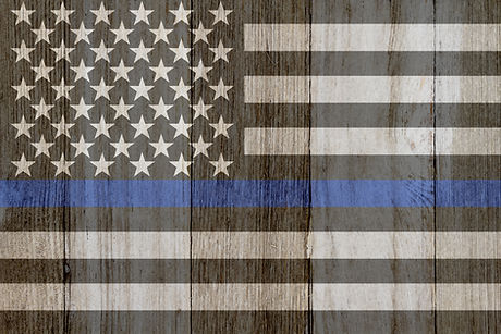 A rustic old thin blue line flag on weat