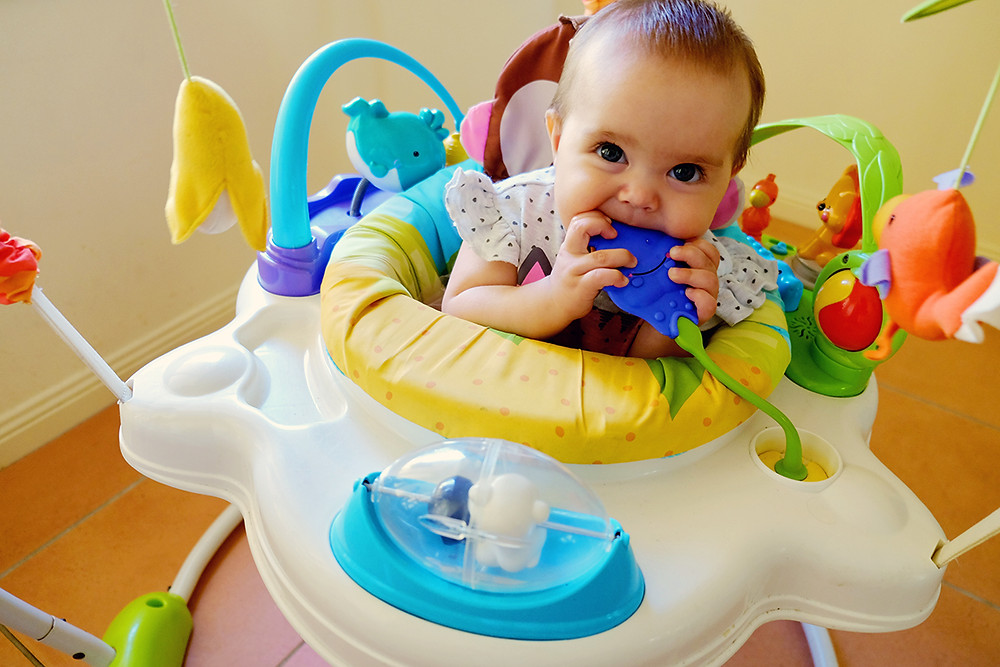 baby exploring through chewing, antenatal advice, baby behaviour, Swaddling To Toddling