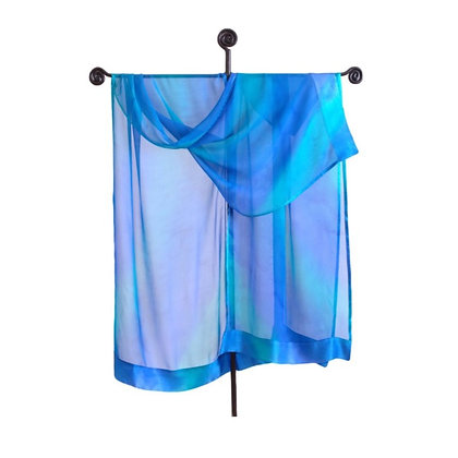 Hand painted silk Ruana in ombré tones of of denim, turquoise, and teal with charcoal. on a tall silver display stand