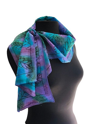 Draped hand painted silk crepe de chine scarf with a graphic daisy motif on a blue and violet purple measuring 8x54 inche