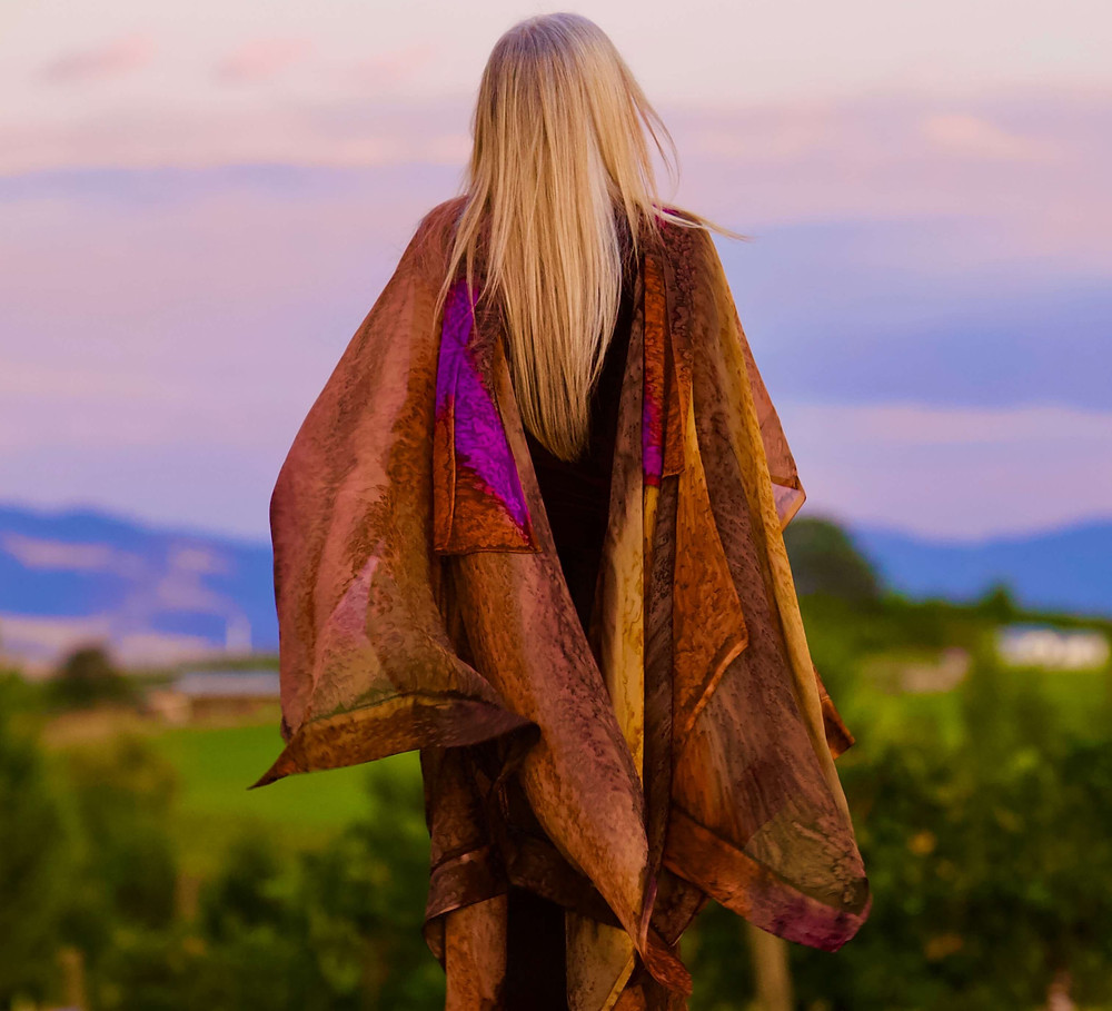 Long Haired Blond Model with Sunset Background modeling Hand Painted Silk Ruana