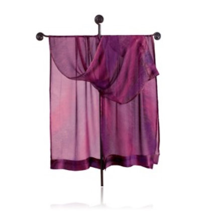 Hand Painted Silk Ruana from the Fire Collection, featuring a plummy ombré of purple and magenta, draped on a tall display