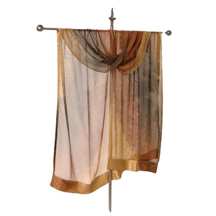 hand painted silk Ruana featuring a graduated ombré of amber, honey and caramel brown hanging on a silver display