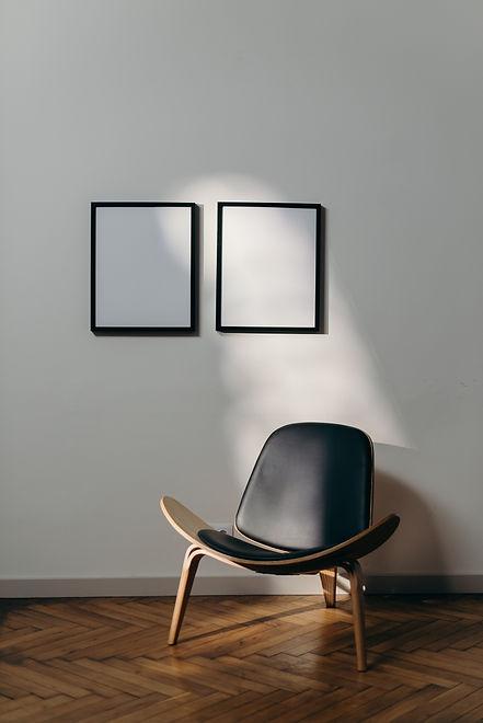 black-wooden-framed-black-padded-armchai