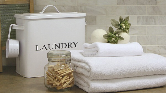 Laundry room sign, white towels and clothespins container