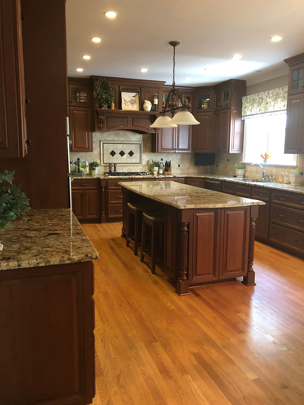 Kitchen with cherry wood cabinets