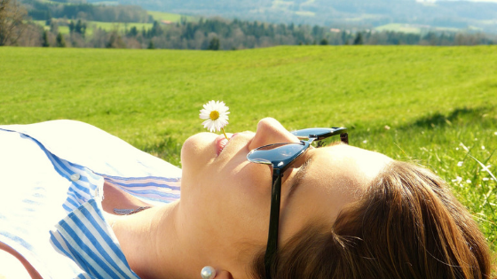 Woman laying in a sunny field