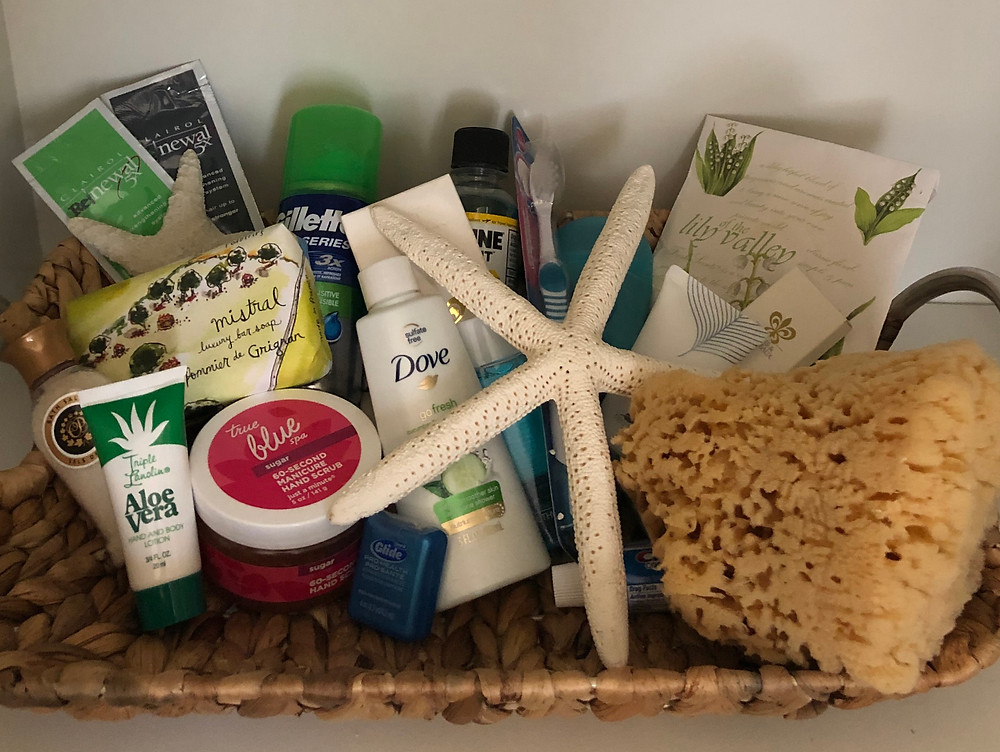 Basket of soaps, lotions and bathroom toiletries