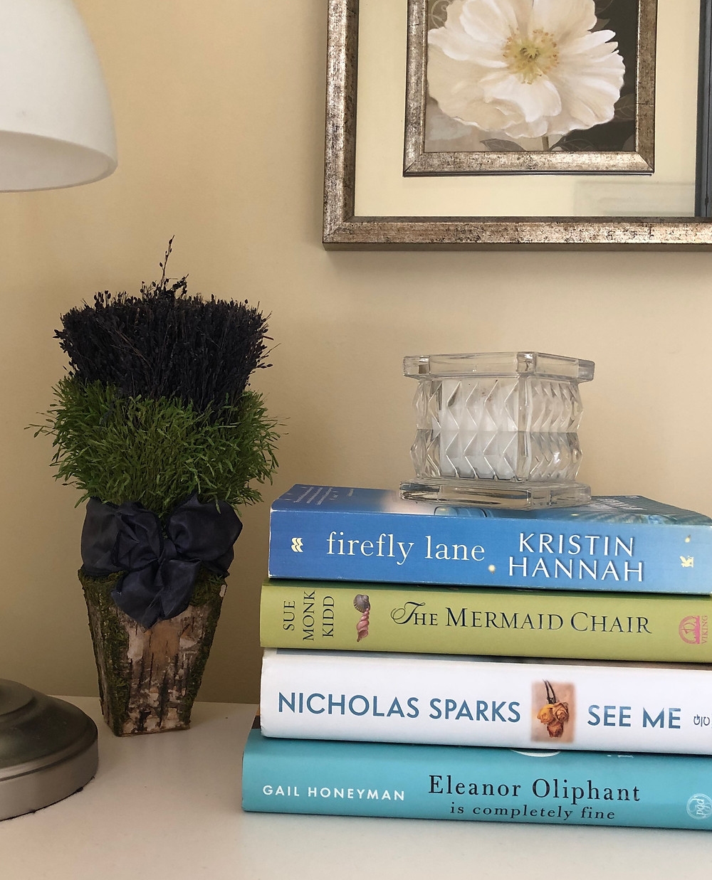 Set of books on a nightstand