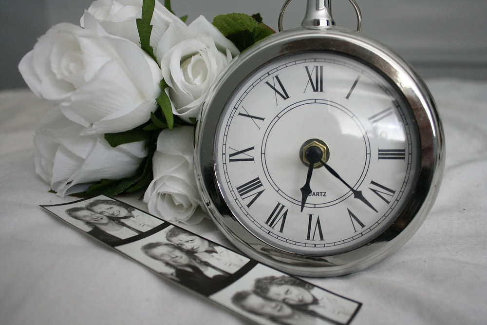 Small clock with flowers and photos