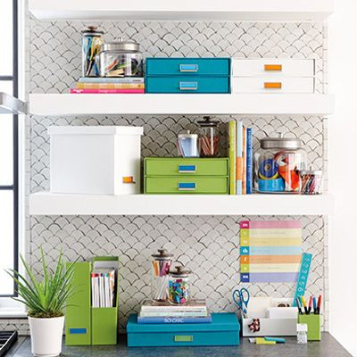Organized office shelving and storage containers for papers, magazines and office supplies