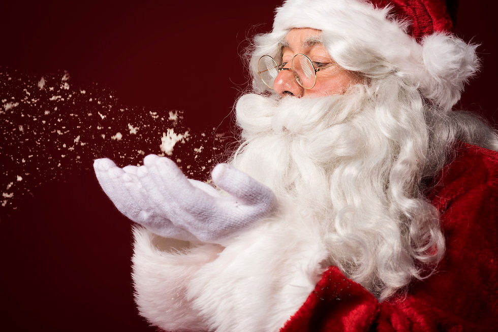 santa-claus-blowing-some-snowflakes-W56J