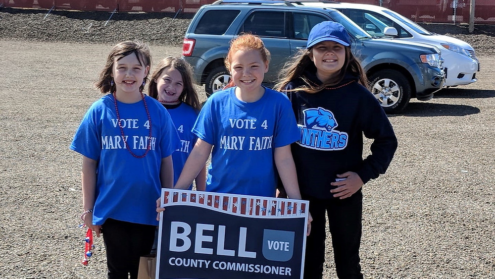 children supporting mary faith bell for county commissioner