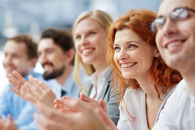 Photo of happy business people applaudin