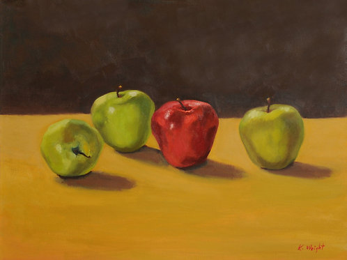 Apples on golden cloth
