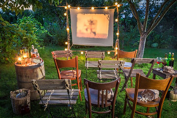 Summer cinema with retro projector in th